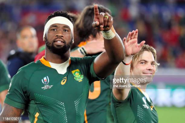 Siya Kolisi and Faf de Klerk and South Africa applaud fans after their victory in the Rugby World Cup 2019 SemiFinal match between Wales and South...