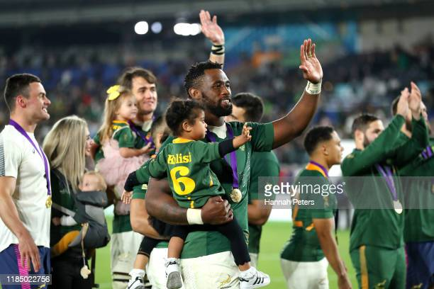 Siya Kolisi of South Africa and his daughter Keziah participate in a lap of honor following his team's victory against England in the Rugby World Cup...