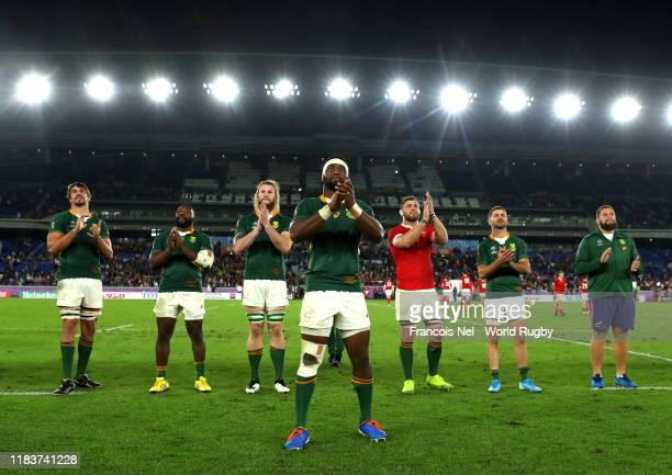 Siya Kolisi of South Africa and teammates applaud fans following their team's victory in the Rugby World Cup 2019 SemiFinal match between Wales and...