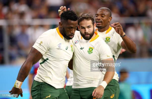 Siya Kolisi of South Africa celebrates with teammate Jacobus Reinach after scoring his team's eighth try during the Rugby World Cup 2019 Group B game...