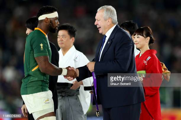 Siya Kolisi of South Africa collects his winners medal from Bill Beaumont Chairman of World Rugby following his team's victory in the Rugby World Cup...