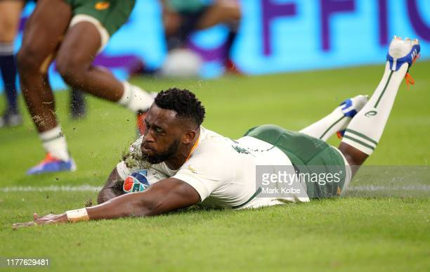 Siya Kolisi of South Africa goes over to score his team's eighth try during the Rugby World Cup 2019 Group B game between South Africa and Namibia at...