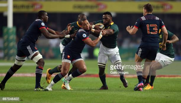 Siya Kolisi of South Africa hands off Gael Fickou of France during the 2nd Castle Lager Incoming Series Test match between South Africa and France at...