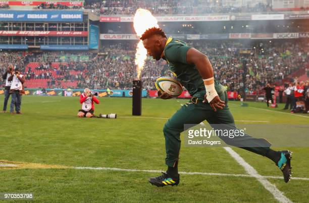 Siya Kolisi of South Africa leads out his team prior to the first test between and South Africa and England at Ellis Park on June 9 2018 in...