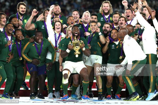 Siya Kolisi of South Africa lifts the Web Ellis cup following his team's victory against England in the Rugby World Cup 2019 Final between England...