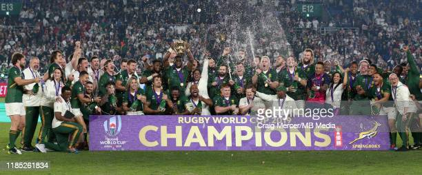 Siya Kolisi of South Africa lifts the Webb Ellis Cup and celebrates with team mates after their side win the Rugby World Cup 2019 Final between...