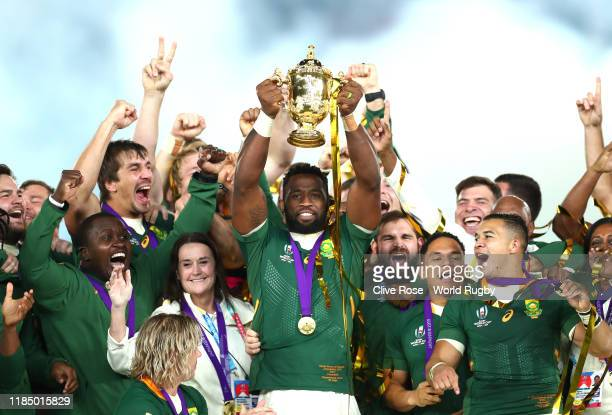 Siya Kolisi of South Africa lifts the Webb Ellis Cup following his team's victory against England in the Rugby World Cup 2019 Final between England...