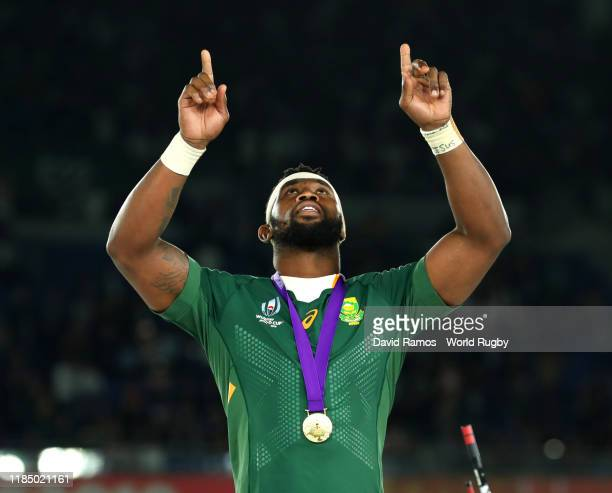 Siya Kolisi of South Africa points to the sky after collecting his winners medal following his team's victory against England in the Rugby World Cup...