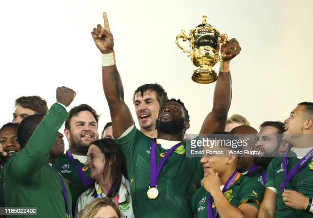 Siya Kolisi of South Africa points to the sky as he lifts the Web Ellis cup following his team's victory against England in the Rugby World Cup 2019...