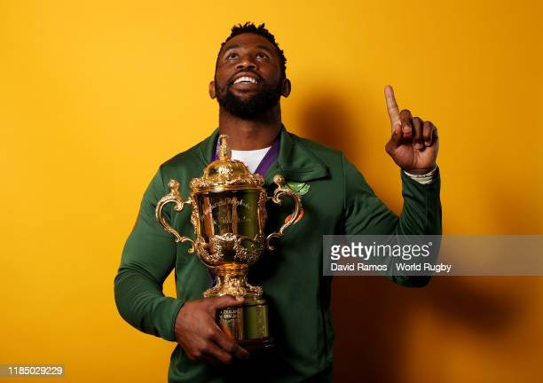Siya Kolisi of South Africa poses for a portrait with the Web Ellis Cup following his team's victory against England in the Rugby World Cup 2019...