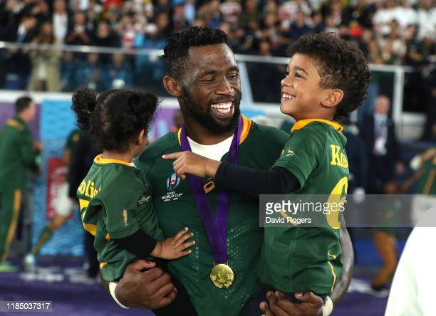 Siya Kolisi of South Africa shares a laugh with his children during the Rugby World Cup 2019 Final between England and South Africa at International...