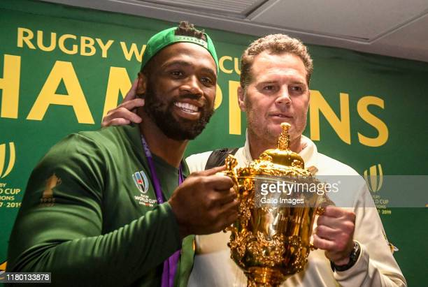 Siya Kolisi of the Springboks poses with the trophy during the South African national rugby team arrival media conference at OR Tambo International...