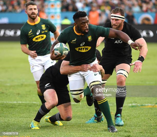 Siya Kolisi of the Springboks tackled by Ryan Crotty of New Zealand during the Rugby Championship match between South Africa and New Zealand at...