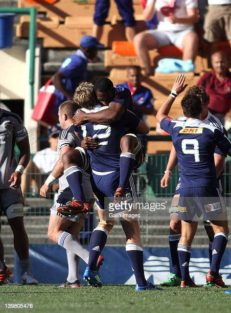 Siya Kolisi of the Stormers celebrates after scoring with Stormers centre Jean de Villiers during the 2012 Super Rugby match between DHL Stormers and...