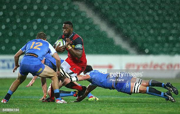 Siya Kolisi of the Stormers looks to avoid being tackled by Kyle Godwin and Richard Hardwick of the Force during the round 16 Super Rugby match...