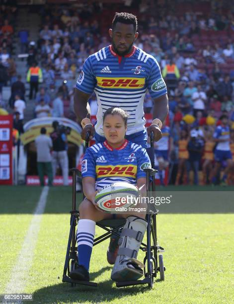 Siya Kolisi of the Stormers walking out with the mascot during the Super Rugby match between DHL Stormers and Toyota Cheetahs at DHL Newlands Stadium...