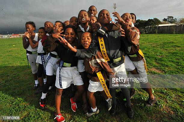 Siya Kolisi poses with kids during the SA Rugby's 67 minutes in honour of Nelson Mandela Day at Siyabulela Primary School Langa Township on July 18...