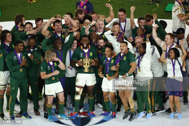 Siya Kolisi the captain of South Africa lifts the Webb Ellis trophy following his sides 3212 victory during the Rugby World Cup 2019 Final between...