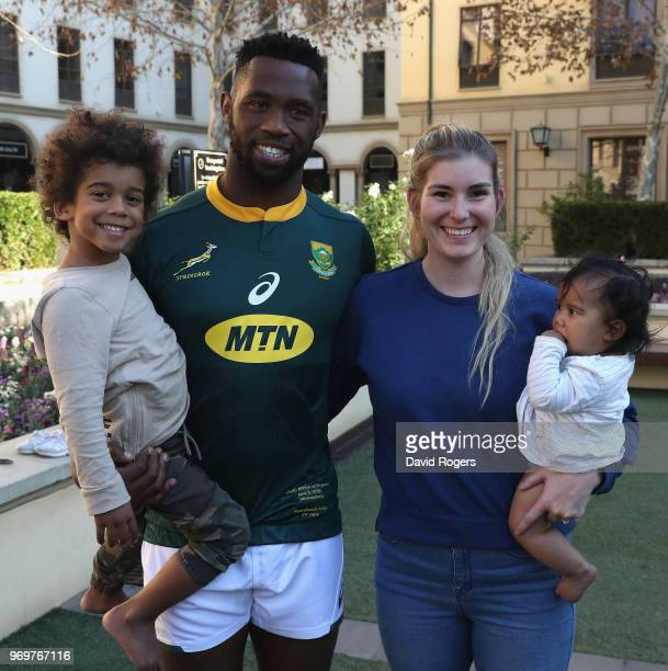Siya Kolisi the first non white captain of the South Africa Springboks poses with his wife Rachel and son Nicholas and daughter Keziah during the...