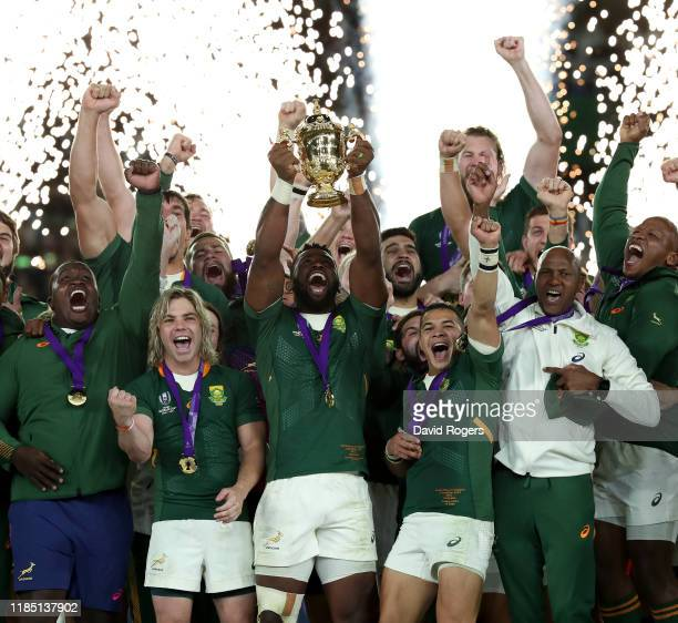 Siya Kolisi the South Africa captain celebrates with team mates after their victory during the Rugby World Cup 2019 Final between England and South...