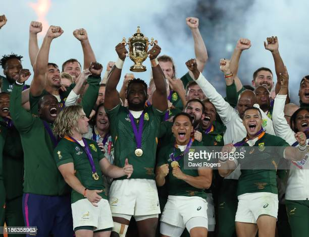 Siya Kolisi, the South Africa captain, raises the Webb Ellis Cup after their victory during the Rugby World Cup 2019 Final between England and South...