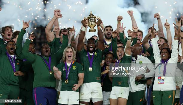 Siya Kolisi the South Africa captain raises the Webb Ellis Cup after their victory during the Rugby World Cup 2019 Final between England and South...
