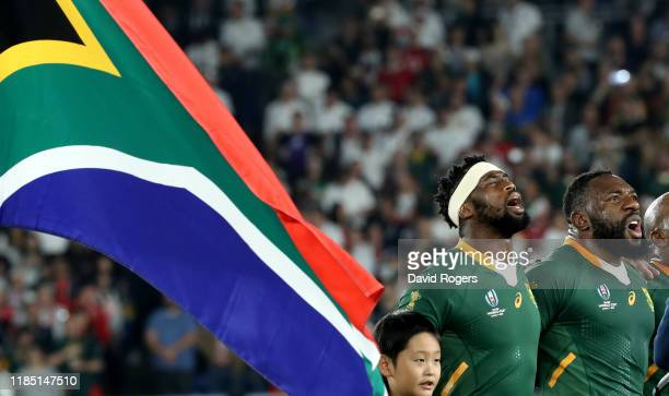 Siya Kolisi the South Africa captain sings the national anthem with team mate Tendai Mtawarira during the Rugby World Cup 2019 Final between England...