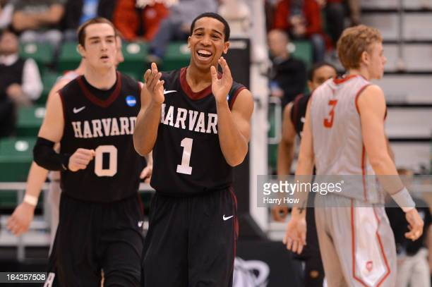 Siyani Chambers of the Harvard Crimson celebrates after making a three-pointer in the second half while taking on the New Mexico Lobos during the...