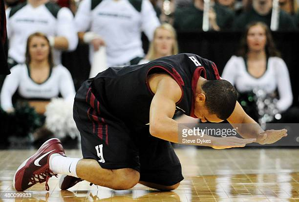 Siyani Chambers of the Harvard Crimson reacts after turning the ball over late in the second half against the Michigan State Spartans during the...