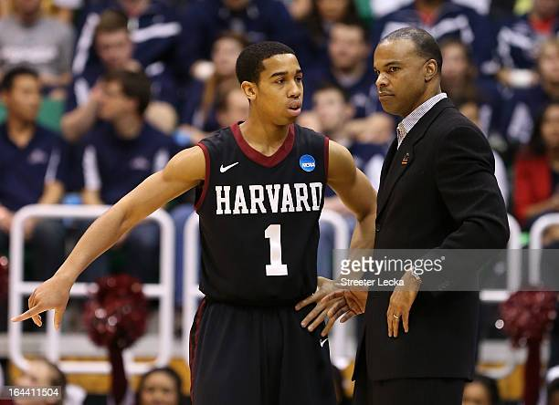 Siyani Chambers talks with head coach Tommy Amaker of the Harvard Crimson in the first half while taking on the Arizona Wildcats during the third...