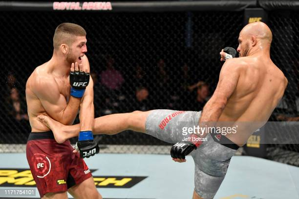Siyar Bahadurzada of Afghanistan kicks Ismail Naurdiev of Austria in their welterweight bout during the UFC Fight Night event at Royal Arena on...