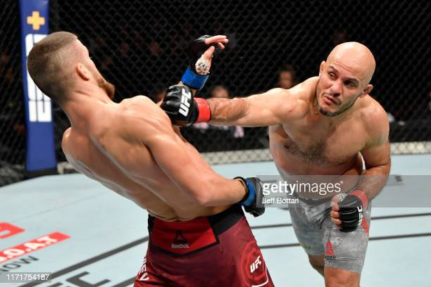 Siyar Bahadurzada of Afghanistan punches Ismail Naurdiev of Austria in their welterweight bout during the UFC Fight Night event at Royal Arena on...