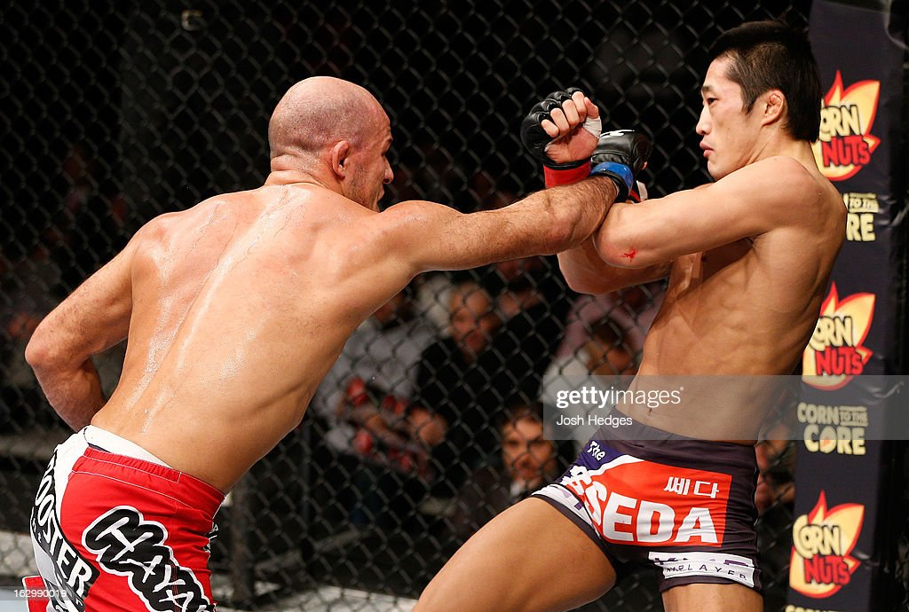 Siyar Bahadurzada punches Dong Hyun Kim in their welterweight fight during the UFC on FUEL TV event at Saitama Super Arena on March 3, 2013 in Saitama, Japan.