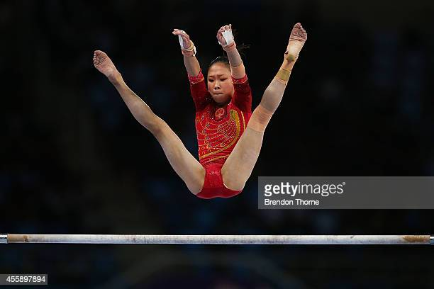 Siyi Chen of China competes in the Qualifying round of the Women's Uneven Bars during day three of the 2014 Asian Games at the Namdong Gymnasium on...
