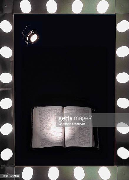 Size as needed Laura Mueller color photo illustration of Bible lit by spotlight