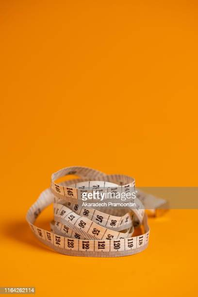 size gauge on orange background. - meter unit of length stock pictures, royalty-free photos & images