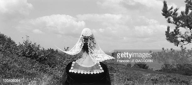 Sizun Brittany France Breton woman in costume from the Baud region of Brittany Ajoncs festival BeuzecCap Sizun Finistere department