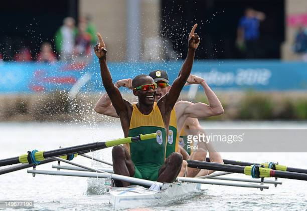 Sizwe Ndlovu John Smith Matthew Brittain and James Thompson of South Africa celebrate after winning gold in the Lightweight Men's Four final on Day 6...