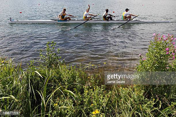 Sizwe Ndlovu John Smith Matthew Brittain and James Thompson of South Africa celebrate in their boat with their gold medals for the Lightweight Men's...