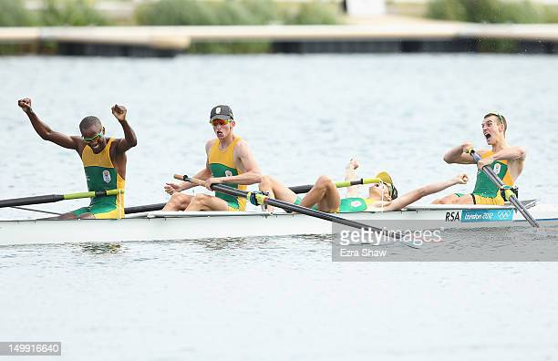 Sizwe Ndlovu John Smith Matthew Brittain and James Thompson of South Africa celebrate winning the gold medal for the Lightweight Men's Four final on...