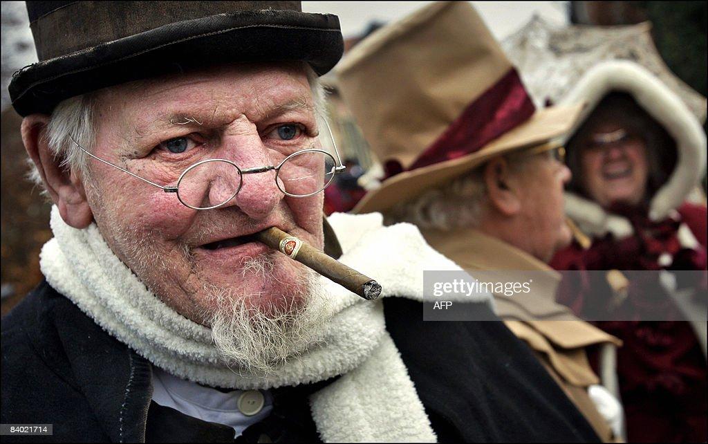 Sjef de Jong, alias 'Scrooge', smokes a : News Photo