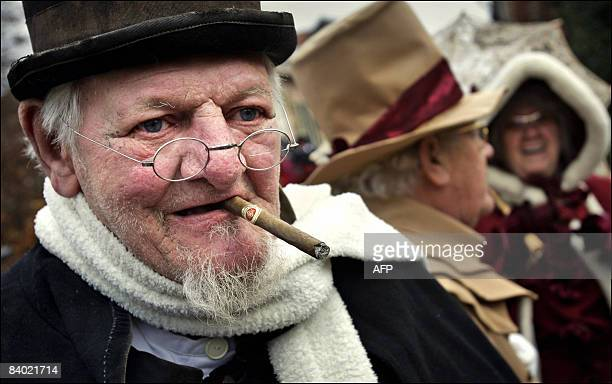 Sjef de Jong alias 'Scrooge' smokes a cigar during a 'Dickens' Festival in the small historic town of Bronkhorst in the Netherlands on December 13...