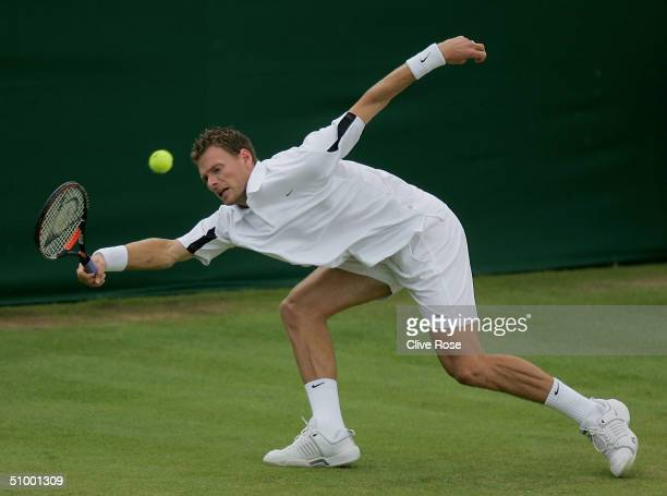 Sjeng Schalken of the Netherlands in action during his third round match against Thomas Enqvist of Sweden at the Wimbledon Lawn Tennis Championship...