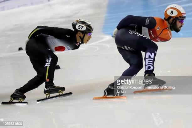 Sjinkie Knegt of Netherlands and Keita Watanabe of Japan skate during the men 1000 meter second semi final during the ISU Short Track World Cup Day 1...