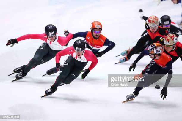 Sjinkie Knegt of Netherlands and Samuel Girard of Canada competes in the Mens 5000m Relay A final race during the Audi ISU World Cup Short Track...