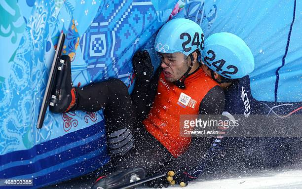 Sjinkie Knegt of Netherlands and Se Young Park of South Korea compete in the Short Track Men's 1500m Final B on day 3 of the Sochi 2014 Winter...