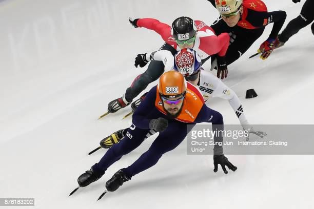 Sjinkie Knegt of Netherlands Charle Cournoyer of Canada and Seo YiRa of South Korea compete in the Men 1000m Quarterfinals during during the Audi ISU...