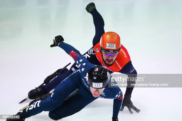 Sjinkie Knegt of Netherlands competes in the Mens 5000m Relay semi finals race during the Audi ISU World Cup Short Track Speed Skating at Optisport...