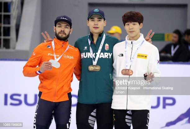 Sjinkie Knegt of Netherlands poses during the medal ceremony after winning the 2nd place Shaong Liu of Hungary poses during the medal ceremony after...