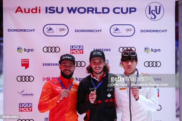 Sjinkie Knegt of Netherlands with the silver medal Samuel Girard of Canada with the gold medal and Dae Heon Hwang of Korea with the bronze medal...